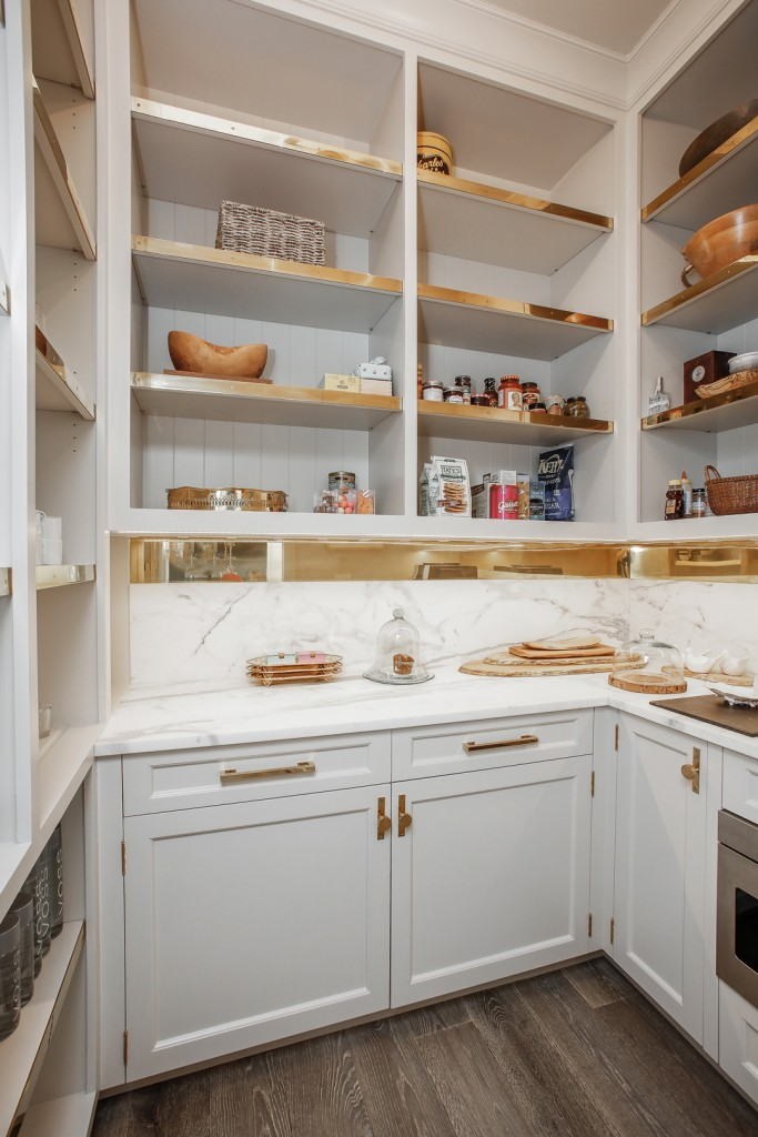 clean butler pantry with mod un-lacquered brass hardware